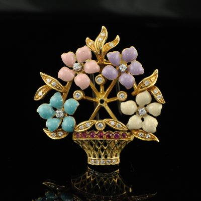 AN ELEGANT DIAMOND RUBY FLOWER BASKET BROOCH