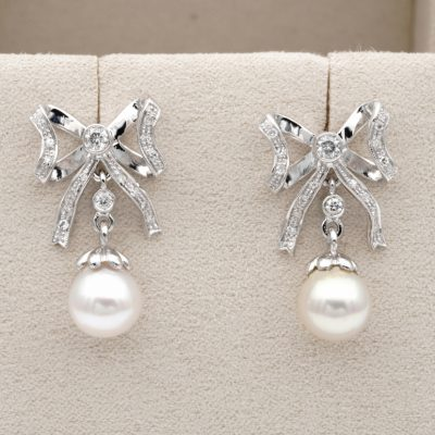 Gorgeous Bow Earrings .60 Ct Diamond 8mm. Cultured Sea Pearl 18 KT Gold Earrings