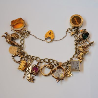 Vintage 16 Charm Bracelet 9ct solid gold English hallmarked