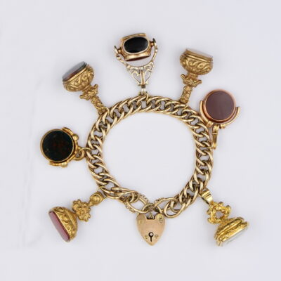 Vintage English Charm Bracelet Loaded with Fobs  9KT gold and Gold cased